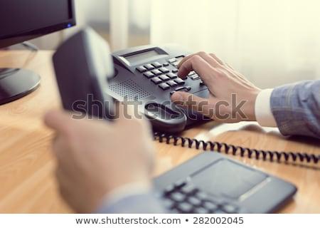 volwassen · zakenman · telefoon · kantoor · portret · zakenman - stockfoto © is2