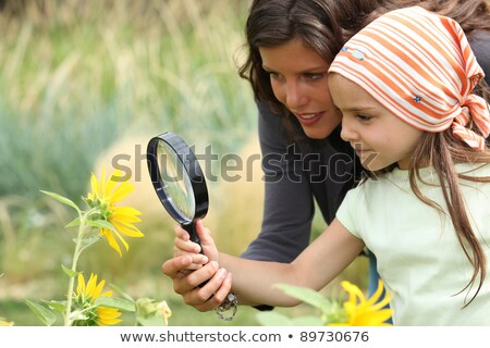 Little girl looking at a snail Stock photo © IS2