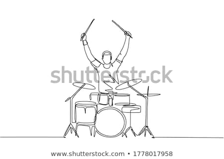 male musician hands with drumsticks at concert stock photo © dolgachov