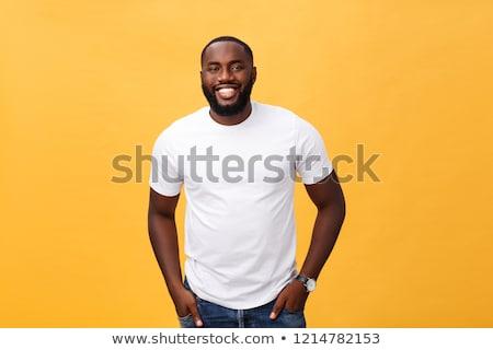 jovem · africano · masculino · trabalhador · indicação · cópia · espaço - foto stock © deandrobot
