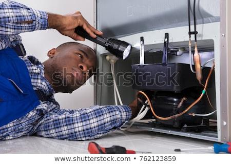 ezermester · hűtőszekrény · elemlámpa · otthon · oldalnézet · férfi - stock fotó © andreypopov