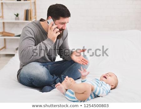 nina · llorando · teléfono · mano · triste · retrato - foto stock © dolgachov