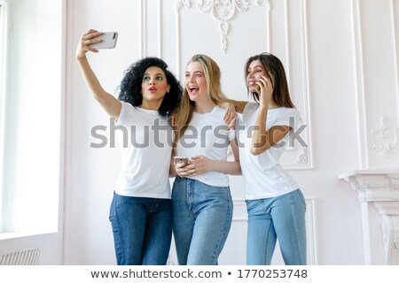 Seductive pretty smiling and taking self portrait. Stock photo © studiolucky