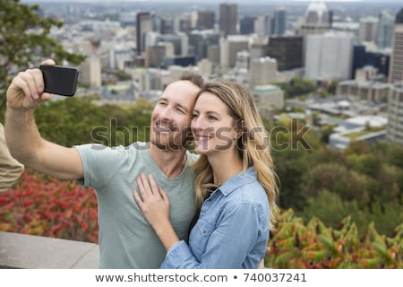 A Happy cute couple enjoy Montreal landscape Stock photo © Lopolo