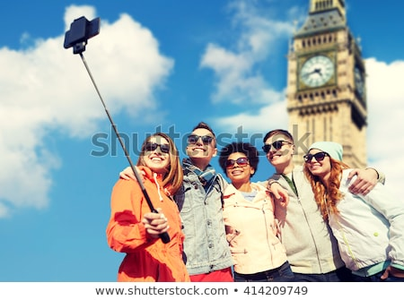 friends taking selfie by monopod in london Stock photo © dolgachov