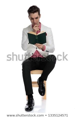 ülő elegáns férfi érdekes olvas fehér Stock fotó © feedough