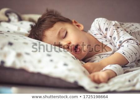 Three boys in blue pajamas Stock photo © colematt