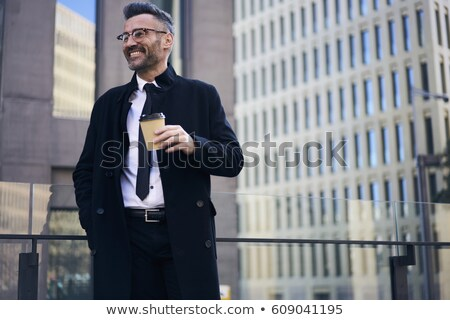 Image of executive director man in stylish wear and glasses sitt Stock photo © deandrobot