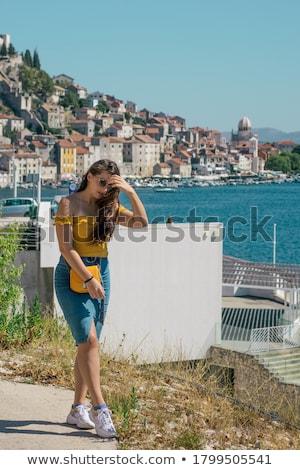 Happy woman by posing near the sea in a hot summer day. Stock photo © ElenaBatkova