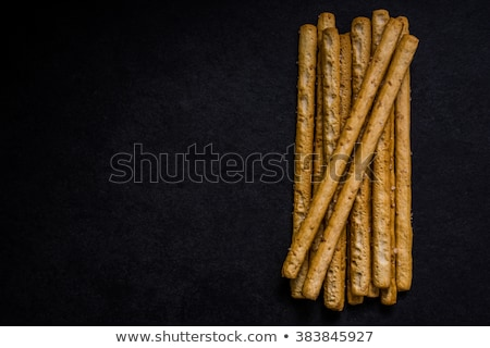 Italian grissini bread sticks with sesame and rosemary herb on b Stock photo © marylooo
