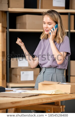 cheerful female customer talking to online shop manager while making order stock photo © pressmaster