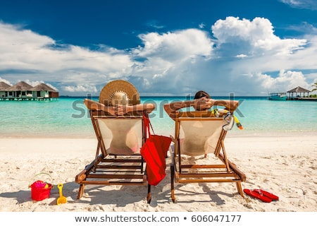 People Traveling, Man and Woman on Resort Beach Stock photo © robuart