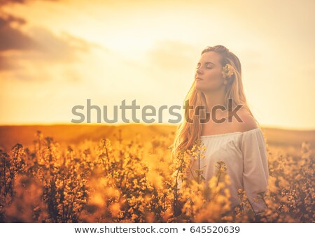 Happy woman in rapeseed field Stock photo © lichtmeister