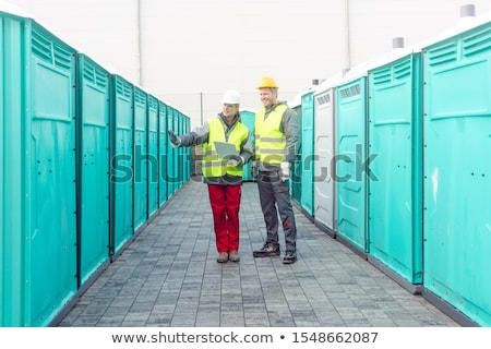 Workers checking the portable toilets for rental Stock photo © Kzenon