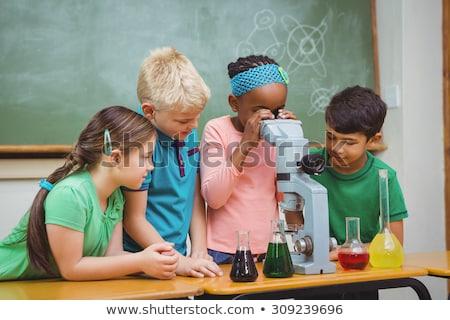 мужчины микроскоп науки класс девушки школы Сток-фото © HighwayStarz