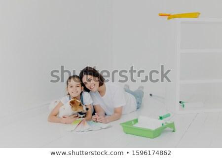 Alegre amigável família cão mentir piso Foto stock © vkstudio
