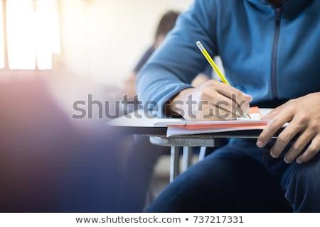 Grupo estudantes escrita corpo palestra ouvir Foto stock © dolgachov