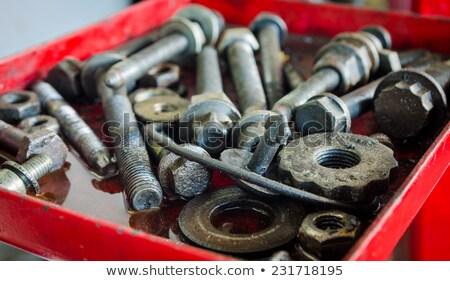 Acél alkatrészek darabok olaj pocsolya koszos Stock fotó © Lopolo