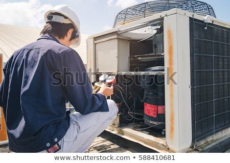 Male Technician Repairing Air Conditioning System Stock photo © AndreyPopov