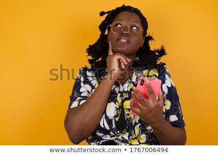 Confundirse jóvenes África mujer teléfono móvil aislado Foto stock © deandrobot