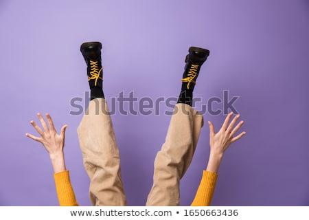 Photo mains jambes velours pants Photo stock © deandrobot