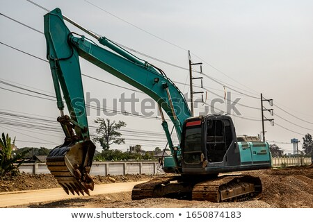 Back hoe vehicle on a pile of dirt Stock photo © stoonn