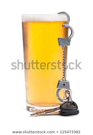 Slusszkulcs pint világos sör üveg sör bent Stock fotó © morrbyte