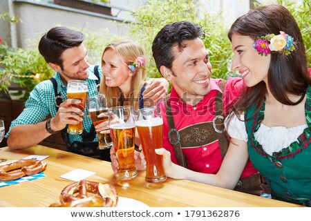 Stock photo: two bavarian girls laughing and drinking beer