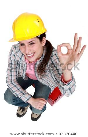 Tradeswoman giving the a-ok sign Stock photo © photography33