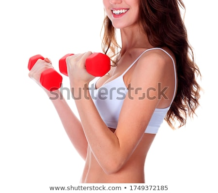 pretty girl with red barbells posing against white background stock photo © nobilior