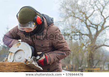 girl with circular saw stock photo © zastavkin
