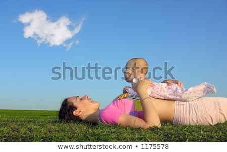 mother with baby on sunset lie from the side 2 with cloud Stock photo © Paha_L