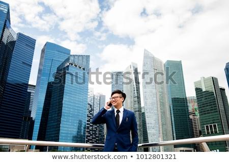 Güneydoğu Asya işadamı silah beyaz portre Stok fotoğraf © szefei