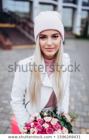 beautiful young woman holding pink rose isolated stock photo © juniart