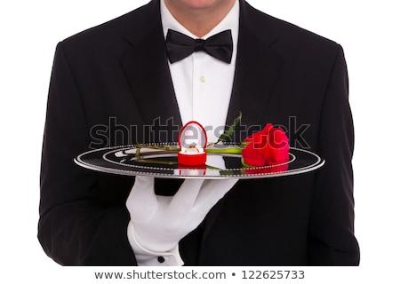 Waiter holding flower on silver tray Stock photo © ozaiachin
