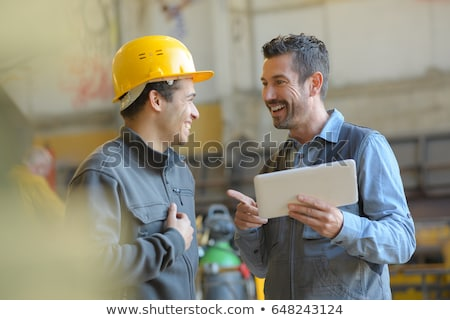 Construction worker in earmuffs Stock photo © photography33