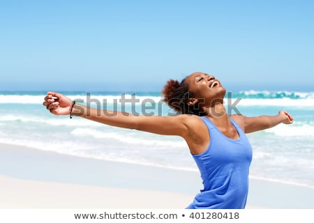 Mosolygó nő sportruha áll nyújtás karok test Stock fotó © wavebreak_media