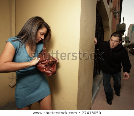 Woman getting her mace to protect herself from the thug who is a Stock photo © dacasdo