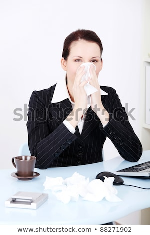Pretty caucasian businesswoman blowing her nose in the office.  Stock photo © dacasdo