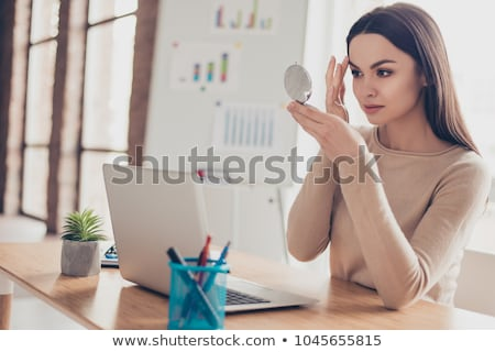Business Woman Doing Touch-Ups stock photo © eldadcarin