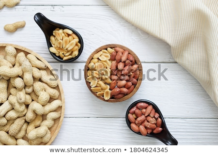 Foto stock: Peanuts Macro Over Wood Background