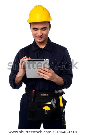 Male architect in a hard hat with toolkit Stock photo © stockyimages