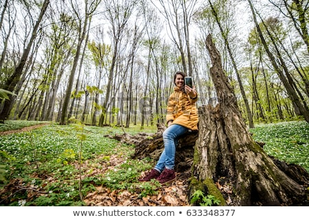 Young beautiful woman on stump Stock photo © Aikon