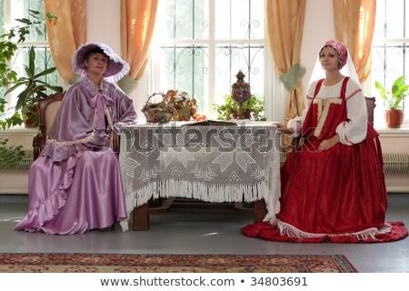 Two beautiful women posing in obsolete interior. Stock photo © Pilgrimego