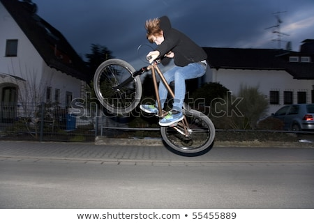 young boy going airborne with bike Stock photo © meinzahn
