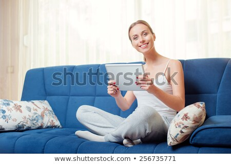 Woman relaxing on a sleeper couch Stock photo © AndreyPopov