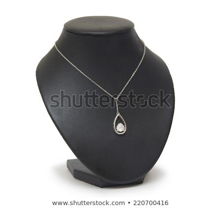 Pendant with blue gem on mannequin isolated on white Stock photo © tetkoren