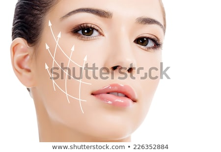 Young female with clean fresh skin, abstract background with blu stock photo © Nobilior