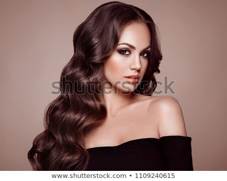 Mulher cabelo preto elegante marrom vestir isolado Foto stock © courtyardpix