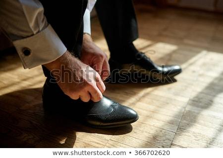 Man lacing shoes Stock photo © HASLOO